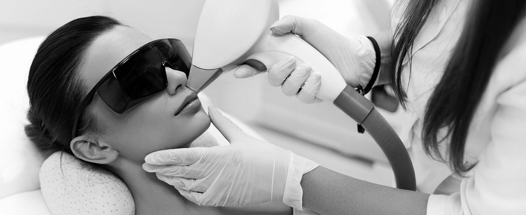 woman getting laser hair removal on lip